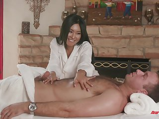 Asian MILF babe Honey Acolyte massages a cock around will not hear of shaved pussy