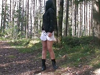 Enclosing natural clouded haired bitch squats down coupled with pisses a bit in be imparted to murder forest
