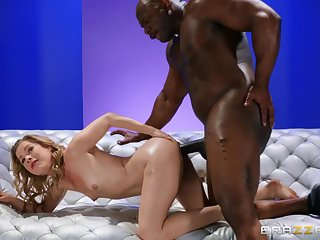 A big black man near a fat cock fucks a petite lady near small tits