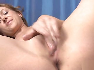 Ideal sweetie is stretching pink twat in close up increased by having orgasm