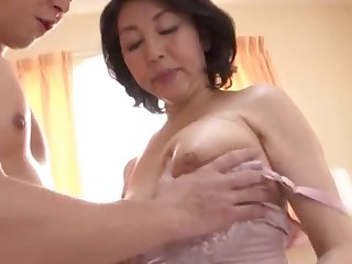 Japanese wife spreads her arms to be fucked by her younger lover