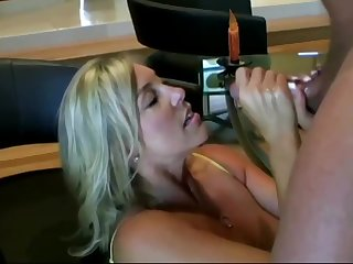 Lusty ash-blonde mommy with colossal boobies is inhaling lollipop while getting on enveloping fours on the floor and getting screwed