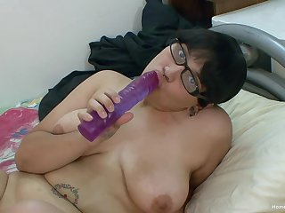 Chunky Asian girl in glasses toys with her big shaved pussy