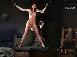 Slim lady is into BDSM together with likes to get whipped very hard, while tied up tight